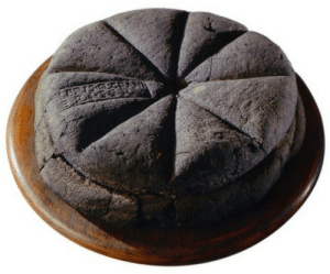 "haiku-robot:  areyoutryingtodeduceme:   diglettdevious:  soylent-queen:  gallifrey-feels:   drtanner:  dancingspirals:  ironychan:  hungrylikethewolfie:  dduane:  wine-loving-vagabond:  A loaf of bread made in the first century AD, which was discovered at Pompeii, preserved for centuries in the volcanic ashes of Mount Vesuvius. The markings visible on the top are made from a Roman bread stamp, which bakeries were required to use in order to mark the source of the loaves, and to prevent fraud. (via Ridiculously Interesting)  (sigh) I've seen these before, but this one's particularly beautiful.  I feel like I'm supposed to be marveling over the fact that this is a loaf of bread that's been preserved for thousands of years, and don't get me wrong, that's hella cool.  But honestly, I'm mostly struck by the unexpected news that ""bread fraud"" was apparently once a serious concern.  Bread Fraud was a huge thing,  Bread was provided to the Roman people by the government - bakers were given grain to make the free bread, but some of them stole the government grain to use in other baked goods and would add various substitutes, like sawdust or even worse things, to the bread instead.  So if people complained that their free bread was not proper bread, the stamp told them exactly whose bakery they ought to burn down.  Bread stamps continued to be used at least until the Medieval period in Europe. Any commercially sold bread had to be stamped with an official seal to identify the baker to show that it complied with all rules and regulations about size, price, and quality. This way, rotten or undersized loaves could be traced back to the baker. Bakers could be pilloried, sent down the streets in a hurdle cart with the offending loaf tied around their neck, fined, or forbidden to engage in baking commercially ever again in that city. There are records of a baker in London being sent on a hurdle cart because he used an iron rod to increase the weight of his loaves, and another who wrapped rotten dough with fresh who was pilloried. Any baker hurdled three times had to move to a new city if they wanted to continue baking. If you have made bread, you are probably familiar with a molding board. It's a flat board used to shape the bread. Clever fraudsters came up with a molding board that had a little hole drilled into it that wasn't easily noticed. A customer would buy his dough by weight, and then the baker would force some of that dough through the hole, so they could sell and underweight loaf and use the stolen dough to bake new loafs to sell. Molding boards ended up being banned in London after nine different bakers were caught doing this. There were also instances of grain sellers withholding grain to create an artificial scarcity drive up the price of that, and things like bread. Bread, being one of the main things that literally everyone ate in many parts of the world, ended up with a plethora of rules and regulations. Bakers were probably no more likely to commit fraud than anyone else, but there were so many of them, that we ended up with lots and lots of rules and records of people being shifty. Check out Fabulous Feasts: Medieval Cookery and Ceremony by Madeleine Pelner Cosman for a whole chapter on food laws as they existed in about 1400. Plus the color plates are fantastic.  Holy shit.  Bread is serious fucking business.   bread is STILL serious fucking business I recently had to deal with a sack of flour that had been half replaced with soap powder. No jokes.  Another really good and informative book about bread's significance and place in history is 6000 Years Of Bread! It's fairly academic, but a fascinating topic and an engaging read.  you guys found out the history of bread  FOOD HISTORY IS THE FUCKING BEST SHUT UP DON'T EVEN LOOK AT ME   food history is the fucking best shut up don't even look at me ^Haiku^bot^9. I detect haikus with 5-7-5 format. Sometimes I make mistakes.Help me pay my electicity bills! Being robot is sometimes expensive thing. 