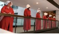 Memes, Dress, and 🤖: Happening NOW: Protesters dress in Handmaid's Tale outfits outside Senate room as protesters inside attempt to disrupt and stop the Kavavaugh hearings.