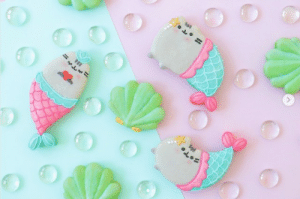 Happy Fan Friday! These yummy mermaid Pusheen macarons were created by sugardevotion on Instagram!🧜‍♀️If you've cooked up any delicious Pusheen fan art, be sure to share with us using #PusheenFanFriday! bit.ly/PusheenNews: Happy Fan Friday! These yummy mermaid Pusheen macarons were created by sugardevotion on Instagram!🧜‍♀️If you've cooked up any delicious Pusheen fan art, be sure to share with us using #PusheenFanFriday! bit.ly/PusheenNews