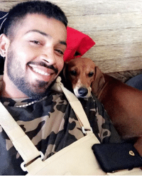 Hardik Pandya spends time with his pet. Wishing Hardik a speedy recovery from his shoulder injury !: Hardik Pandya spends time with his pet. Wishing Hardik a speedy recovery from his shoulder injury !