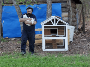 He said today that his cat brings him joy. Today he assembled a chicken coop and created a catio cat coop so his kitty can go out side and be safe from foxes and coyote. He carries his kitty to and from the coop like a baby.: He said today that his cat brings him joy. Today he assembled a chicken coop and created a catio cat coop so his kitty can go out side and be safe from foxes and coyote. He carries his kitty to and from the coop like a baby.