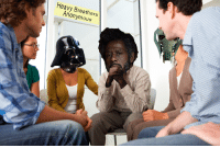 """Dank, Anonymous, and Anonymity: Heavy Breathers  Anonymous """"Everyone, please welcome our newest member to the Heavy Breathers support group, Saw Gerrera."""""""