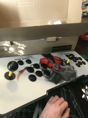 Got this fight stick for Christmas. Comes with 100+ fighting games already downloaded: = hel achine  Dstinit Home  lesional Design & Reable Quality  High-Definition Home Game Machine  Aw euorssaoouae  CON START  COIN START  Olld Got this fight stick for Christmas. Comes with 100+ fighting games already downloaded