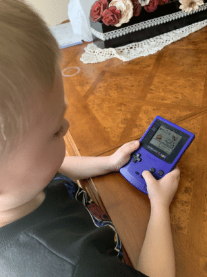 Helping him with his first play through of Gold on the same gameboy I used as a kid :): Helping him with his first play through of Gold on the same gameboy I used as a kid :)