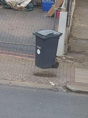 Here's a gravity defying trash can: Here's a gravity defying trash can