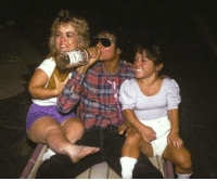 Heres a photo of Michael Jackson drinking a bottle of vodka and chilling with some midgets: Heres a photo of Michael Jackson drinking a bottle of vodka and chilling with some midgets