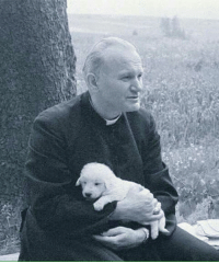 Here's a picture of Saint John Paul II holding a puppy to brighten your Wednesday.: Here's a picture of Saint John Paul II holding a puppy to brighten your Wednesday.