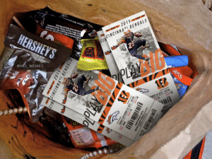 PARENTS! Make sure to check your children's candy this Halloween. Just found Bengals tickets in my kid's Halloween bag. Some sick people out there... https://t.co/RfD0109zu7: HERSHEY'S  Artificial And Natural Flavors.  Skim Milk, Cocoa, Whey, Soya Lecithin,  Hydrogenated Soybean Oil, Condensed  Ingredients:Sugar, Corn Syup,raruany  HILK CHO4  Tootsie Roll Industries  @NFL_MEMES  W 2019 W  CINCINNATI BENGALS  CIN  25  PLAY  eto  ఎ¥C  caCAn BENGALS  EMBER 18, 2019-100 PM  OW 18  SEAT 98  NET WT  GATE  cKE  VW2019  CINNCINNATI BENGALS  PPLAY  asan ENGALS  MBER 18, 2019-1:00 PM  SEAT 98  SUNDA  SEC. WWL  ROW 18  THWEST GATE PARENTS! Make sure to check your children's candy this Halloween. Just found Bengals tickets in my kid's Halloween bag. Some sick people out there... https://t.co/RfD0109zu7