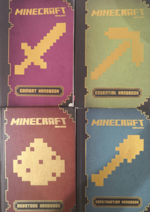 Going through my old books and found these: HINECRAFT  HINECRAFT  SMOJANG  MOJANG  COMBAT HANDEDOK  ESSENTIAL HANDEDOK  MINECRAFT  1 HINECRAFT  ERMOJANG  MOJANG  CONSTRUCTION HANDEOOK  REDSTONE HANDEDDN Going through my old books and found these