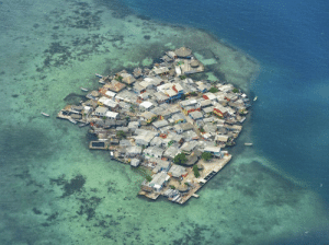 Bailey Jay, Tumblr, and Blog: historical-nonfiction:    This little island, perched on coral, has a higher population density than Manhattan. In fact, it's density is four times that of Manhattan! It is only 2.4 acres in size, yet, it's home to 1,200 people. Santa Cruz del Islote is a small island in an archipelago off the coast of Colombia. With no water, and electricity just 5 hours a day, why does anyone live here?Legend has it that about 150 years ago, a group of fishermen from the coastal town of Baru, about 50 km away, were looking for new waters to fish when they stumbled upon this small coral island, sitting low in the waters. As it was too late to return, the fishermen decided to set up camp on the island for the night and were pleasantly surprised to discover that the island had no mosquitoes, a rarity in the area. The story goes that the men slept so peacefully that night that they decided to stay.    I believe this myth I hate mosquitoes that much too