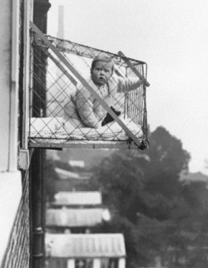historicaltimes:  Suspended baby cages to ensure that children get enough sunlight and fresh air when living in an apartment building, ca. 1937 via reddit  Bring this back: historicaltimes:  Suspended baby cages to ensure that children get enough sunlight and fresh air when living in an apartment building, ca. 1937 via reddit  Bring this back