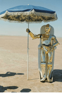 historycultureeducation:  Anthony Daniels in his C-3P0 suit, trying to get some shade, on the set of Star Wars, 1970s: historycultureeducation:  Anthony Daniels in his C-3P0 suit, trying to get some shade, on the set of Star Wars, 1970s