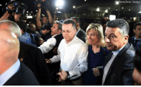 Friday, Memes, and American: hoto/Emre Tazegul Pastor Andrew Brunson has landed at Ramstein Air Base in Germany. This photo shows the American pastor and his wife arriving for the flight Friday after a Turkish court convicted him on terror charges, but sentenced him to time served and allowed him to leave.