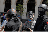 How To Dress for the Revolution, Medic's gear: As a protester a number of simple steps can help greatly in combating the efficiency of a chemical weapon's & projectiles' ability to harm you. The following are a list of general guidelines, followed by a complete list of clothing items to bring.  Rain gear, water resistant, chemical resistant (Tyvek suit) and synthetic clothes as outer layers tend to be police chemical resistant too.  However, you can sweat a lot in non breathable clothes. Cover up as much as possible to protect skin from tear gas or pepper spray exposure.  Wear clinched wrist and ankle clothing.   Avoid cotton, polar-fleece and wool as outer layers, which are fuzzy and absorb chemicals. Rinse clothes after washing well. Used mild or non-detergent soaps. This is because detergents enhance the effects of the chemicals on one's skin.    The following is a list of clothing a protester could wear at a demo risking police violence. ·        Rain  or water resistant clothes and hat · ·        Comfortable & dry shoes, running shoes or sturdy boots ·        Sealed Goggles, (swim or ski) for chemical weapons.       Helmet: bicycle. Consider hockey helmet with clear face shield (good against pucks and rubber bullets). ·        Gas Mask, Face Filter, Respirator or Bandana soaked in apple cider vinegar or lemon juice for tear gas or pepper spray.           ·        Spare Clothes & sealed bag ·        Heavy Work Gloves for removing hot tear gas canisters. ·        Bicycle, sports, motorcycle or military helmets with shatter resistant face shields if chance of plastic & rubber bullets. *    Padded Pants, or Goalie Pads for sit-downs.   On the other hand, maybe you should NOT LOOK LIKE A PROTESTER to avoid police attention. Bring or wear straight clothes, makeup, brand name shopping bag, a business or secretary suit, construction clothes, etc. to blend in with non-protesters. Do Not Wear: Piercings, jewellery, ties, or anything else that can be grabbed by the police