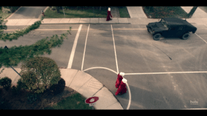 """In The Handmaid's Tale, the stop signs have a hand signal instead of the word """"stop"""" because the women are not permitted to read.: hulu  ORIGINALS In The Handmaid's Tale, the stop signs have a hand signal instead of the word """"stop"""" because the women are not permitted to read."""