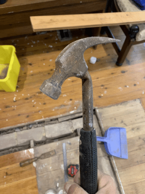 I broke a hammer trying to pry a nail out of the floorboards and it looks really disappointed in itself: I broke a hammer trying to pry a nail out of the floorboards and it looks really disappointed in itself