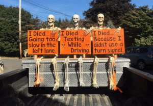 We decorated the truck for Halloween: I Died.. I Died..  Texting  While  Driving turn signal.  I Died...  Going too  slow in the  left lane.  Because I  didn't use a  HI We decorated the truck for Halloween