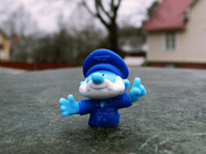 I love taking pictures of forgotten or lost objects. Someone left this Papa Smurf toy on a distributor box.: I love taking pictures of forgotten or lost objects. Someone left this Papa Smurf toy on a distributor box.