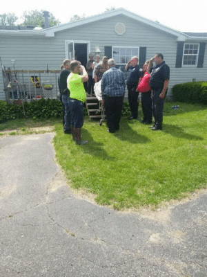 Family, Fire, and Friends: I used to live in a REALLY small town in Michigan. Yesterday, a man who was with the local Fire Department for over 30 years there died from kidney failure. Here he gets salutes from his friends, family, and colleagues as he is taken away.