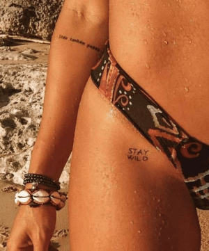 I wanna get a tattoo on my hip like in the picture. What should I get? ALL suggestions are welcome :): I wanna get a tattoo on my hip like in the picture. What should I get? ALL suggestions are welcome :)