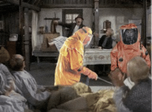 Willy Wonka, Grandpa, and Chocolate: If you pause the Willy Wonka & the Chocolate Factory at just the right time you can see 2 people in hazmat suits cleaning Grandpa Joe's side of the bed after he gets out of it.