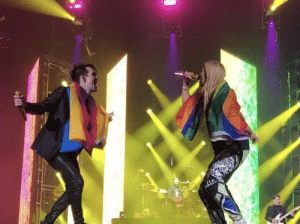 Energy, Girls, and Singing: ilovemygaydad: wallflowerlisa:  Hayley Kiyoko and Brendon Urie with their flags while singing Girls/Girls/Boys is so iconic!  The raw gay energy in this photo is enough to power an entire country