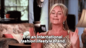 Fashion, Lifestyle, and International: I'm an international  fashion lifestyle brand Wearing shorts to show off my shaved legs while wearing a sweater to hide my lack of chest and unshaved arms.