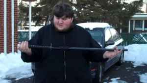 American, Japanese, and Katana: Imperial Japanese officer inspects his katana before executing an American POW. (circa 1943, colorized)