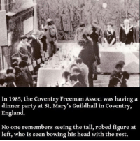 At-St, Creepy, and England: In 1985, the Coventry Freeman Assoc. was having a  dinner party at St. Mary's Guildhall in Coventry,  England.  No one remembers seeing the tall, robed figure at  left, who is seen bowing his head with the rest. Going private soon! Follow me @creepy.fact for more scary stuff 👻☠️