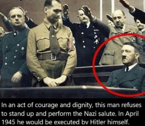 The first anti-Nazi movement in Germany, 1943 (colorised): In an act of courage and dignity, this man refuses  to stand up and perform the Nazi salute. In April  1945 he would be executed bv Hitler himself. The first anti-Nazi movement in Germany, 1943 (colorised)