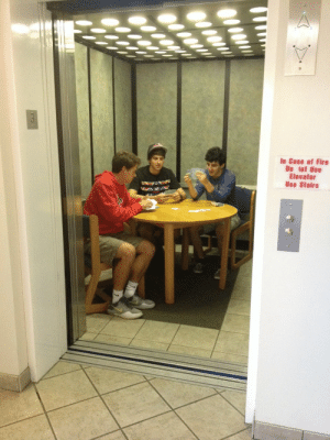 """haedia:  thewolfofnibu:  stahscre4m:  there are guys in my dorm who decided to play cards in the elevator  see what intrigues me about college isn't the intellectual pursuit or the bonding or whatever, its the fact that people have the freedom to do random shit like this  Okay, everybody, I have a story about random shit in college. When I was in college, there was a particular class I took where, no matter what time you walked into class, if you made it into the room before the professor, you wouldn't be counted late. I mean, that's a pretty cool policy, given how some professors are really obnoxious about attendance. Well, one time, a fellow student of mine was running late to class. As she reached the edge of the building, she saw her professor making it to the front steps (super long rectangular building here). He looks up from walking and he sees her. He then points to his watch, gives her a well-meaning """"Look who's late"""" face, and walks on inside. What he didn't know, though, was that this particular student was like freakishly good at bouldering and related climbing skills, so she was just like """"Fuck it"""" and SCALED THE BUILDING! She tapped on the window of the 4th floor classroom (the floors had like 20ft ceilings, so, she was quite a ways up there), nearly making one student piss himself. They opened the window, she rolled through, onto the floor, and slid into her seat about five seconds before the professor opened the door to the classroom. He did a double take, started to say """"How the hell d—"""" when a security guard ran in, red-faced and panting, pointed at her and bellowed """"STOP DOING THAT!"""" : In Case of Fire  Do lot Use  Elevator  Use Stairs haedia:  thewolfofnibu:  stahscre4m:  there are guys in my dorm who decided to play cards in the elevator  see what intrigues me about college isn't the intellectual pursuit or the bonding or whatever, its the fact that people have the freedom to do random shit like this  Okay, everybody, I have a story about random """