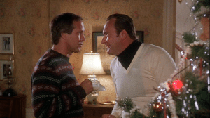 In Christmas Vacation (1989) if you look closely you can see Cousin Eddie wearing a cut out turtle neck under his sweater. Most likely because he is poor but still wants to look good while saving a buck.: In Christmas Vacation (1989) if you look closely you can see Cousin Eddie wearing a cut out turtle neck under his sweater. Most likely because he is poor but still wants to look good while saving a buck.