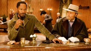 In Django Unchained (2012), a man asks Django what his name is and how it's spelled. Django says his name, spells it out, and adds that 'the D is silent.' The man responds with 'I know.' The man is played by Franco Nero, who played Django in the 1966 film.: In Django Unchained (2012), a man asks Django what his name is and how it's spelled. Django says his name, spells it out, and adds that 'the D is silent.' The man responds with 'I know.' The man is played by Franco Nero, who played Django in the 1966 film.