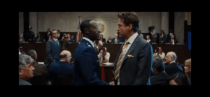 """In Iron Man 2 (2010), Rhodes (War Machine) enters the courtroom saying """"it's me, I'm here, deal with it"""", a not-subtle reference to the recasting of the character from Terrence Howard to Don Cheadle.: In Iron Man 2 (2010), Rhodes (War Machine) enters the courtroom saying """"it's me, I'm here, deal with it"""", a not-subtle reference to the recasting of the character from Terrence Howard to Don Cheadle."""