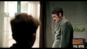 In Jojo Rabbit (2019), Hitler is shown out of his normal mustard yellow outfit and is in a gray outfit. Also, you can see the bullet wound in his head after real Hitler killed himself: In Jojo Rabbit (2019), Hitler is shown out of his normal mustard yellow outfit and is in a gray outfit. Also, you can see the bullet wound in his head after real Hitler killed himself