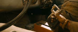 In Mad Max: Fury Road, there is a quick shot where The People Eater's gear shift is shown to be a revolver.: In Mad Max: Fury Road, there is a quick shot where The People Eater's gear shift is shown to be a revolver.