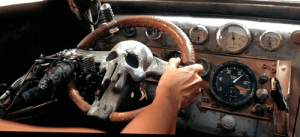 In Mad Max: Fury Road, there's a handgun in a holster on the dashboard of Furiosa's war-rig. This would be very useful for quickly shooting someone.: In Mad Max: Fury Road, there's a handgun in a holster on the dashboard of Furiosa's war-rig. This would be very useful for quickly shooting someone.