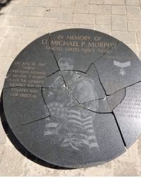 "Cash reward to the person that finds out who did this to the Monument. What a disgrace. The centerpiece of Lt. Michael P. Murphy Memorial Park in Lake Ronkonkoma has been smashed to pieces by vandals. A photo shared on Facebook shows the black granite stone broken into numerous pieces at the park located on Lake Shore Road. Suffolk County Police say a report was filed Thursday. No arrests have been made. ""The Fourth Precinct is assigned to the case,"" Suffolk County Police Commissioner Geraldine Hart said in a statement Thursday night. ""We encourage anyone who may have information to come forward and contact Crime Stoppers at 1-800-220-TIPS. A Crime Stoppers fast cash reward of $2,500 has been made available."" ・・・ To donate towards repairs go to MurphFoundation.org.: IN MEMORY OR  LT MICHAEL P MURPHY  UNITED STATES NAVY SEA  ON JUNE 28 200s  DURING  OPERATION REDWING  T MICHALL P MURP  MADE THE ULIMAE  rR  ONS  DUT  ELECT  RHOT UPO  AND UPHE  HEST TRADT  SACRIFICE FOR H  COUNTRY AND  OUR FREEDOM  直E-UNITED STA  AVAL SERVICE Cash reward to the person that finds out who did this to the Monument. What a disgrace. The centerpiece of Lt. Michael P. Murphy Memorial Park in Lake Ronkonkoma has been smashed to pieces by vandals. A photo shared on Facebook shows the black granite stone broken into numerous pieces at the park located on Lake Shore Road. Suffolk County Police say a report was filed Thursday. No arrests have been made. ""The Fourth Precinct is assigned to the case,"" Suffolk County Police Commissioner Geraldine Hart said in a statement Thursday night. ""We encourage anyone who may have information to come forward and contact Crime Stoppers at 1-800-220-TIPS. A Crime Stoppers fast cash reward of $2,500 has been made available."" ・・・ To donate towards repairs go to MurphFoundation.org."
