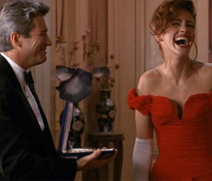 In Pretty Woman (1990), Julia Roberts began using a skull wrangler to help her close her massive mouth when it got stuck.: In Pretty Woman (1990), Julia Roberts began using a skull wrangler to help her close her massive mouth when it got stuck.