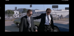 In Reservoir Dogs (1992), just seconds after Mr White shoots dead two policemen in their squad car, there is a small group of people nearby who haven't reacted.: In Reservoir Dogs (1992), just seconds after Mr White shoots dead two policemen in their squad car, there is a small group of people nearby who haven't reacted.