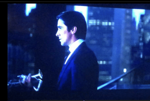In The Dark Knight (2008), Bruce Wayne toasts Harvey Dent and then promptly walks out onto the balcony and dumps his drink over the railing: In The Dark Knight (2008), Bruce Wayne toasts Harvey Dent and then promptly walks out onto the balcony and dumps his drink over the railing