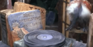 """In The Flintstones (1994), during Fred's party, the record player has """"Bone To Run"""" by Bruce Springstone next to it - recreated album cover and everything. Also notice T. Rex in the background.: In The Flintstones (1994), during Fred's party, the record player has """"Bone To Run"""" by Bruce Springstone next to it - recreated album cover and everything. Also notice T. Rex in the background."""