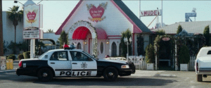 In The Hangover (2009), a strip club can be seen behind the wedding chapel, foreshadowing Stu's marriage to a stripper: In The Hangover (2009), a strip club can be seen behind the wedding chapel, foreshadowing Stu's marriage to a stripper