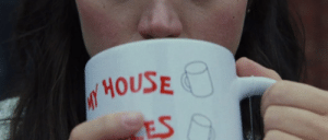 """In the last frame of Knives Out (2019) we can see Marta sipping from Harlan's mug. Her hands cover the print on it, expect for """"my house"""": In the last frame of Knives Out (2019) we can see Marta sipping from Harlan's mug. Her hands cover the print on it, expect for """"my house"""""""