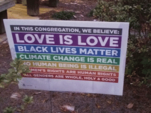 Wholesome baptism party.: IN THIS CONGREGATION, WE BELIEVE:  LOVE IS LOVE  BLACK LIVES MATTER  CLIMATE CHANGE IS REAL  NO HUMAN BEING IS ILLEGAL  MEN'S RIGHTS ARE HUMAN RIGHTS  ALL GENDERS ARE WHOLE, HOLY & GOOD Wholesome baptism party.
