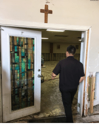 In this photo, the Rev. Mark Goring surveys damage from HurricaneHarvey at a church community center in Houston. The Catholic priest has been inundated with requests for spiritual guidance in the aftermath of the storm, but has also been tending to people's material needs, organizing a huge relief effort.: In this photo, the Rev. Mark Goring surveys damage from HurricaneHarvey at a church community center in Houston. The Catholic priest has been inundated with requests for spiritual guidance in the aftermath of the storm, but has also been tending to people's material needs, organizing a huge relief effort.