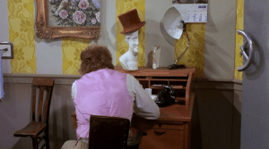 In Willy Wonka and the Chocolate Factory (1971) everything in Wonka's office is cut in half. This is because Willy Wonka's wife took half of it in the divorce.: In Willy Wonka and the Chocolate Factory (1971) everything in Wonka's office is cut in half. This is because Willy Wonka's wife took half of it in the divorce.