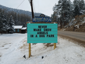 Clever advice though: INDIAN HILL  COMMUNITY CENTER  NEVER  MAKE SNOW  ANGELS  IN A DOG PARK Clever advice though