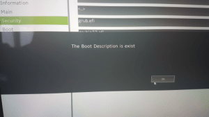 Information, Laptop, and Engrish: Information  <..>  Main  Security  grub.efi  Boot  The Boot Description is exist  Ok my laptop showed this im scared