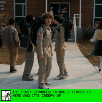"Lurking, Memes, and Indiana: INS  LE  OL  THE FIRST STRANGER THINGS 2 TEASER IS  HERE AND IT'S CREEPY AF  NEWS Netflix dropped the first promo for the anticipated second season of Stranger Things on Super Bowl Sunday, and it looks like Hawkins, Indiana has seen better days. Stranger Things 2 will pick up a year after the events of the first season, in the fall of 1984 — note Dustin, Lucas, and Mike's Ghostbusters uniforms — and judging from this teaser, a creepy kaiju monster from the Upside Down is coming to town. Or at least it's been haunting poor Will Byers's dreams since he escaped the alternate dimension. Per Netflix, ""Everything seems back to normal ... but a darkness lurks just beneath the surface, threatening all of Hawkins."" That darkness has apparently manifested itself into that giant arachnid in Will's visions. The promo also gives us our first real glimpse of Millie Bobby Brown's Eleven back in action. Wherever she is, she's upside down (in the Upside Down?) and bleeding from her nose. When they eventually pull Eleven out of whatever dimension she's in, Mike better have a Ghostbusters uniform ready and waiting for her. (And is that Chief Hopper dressed like Indiana Jones?! Be still our beating hearts.) by Crystal Bell"